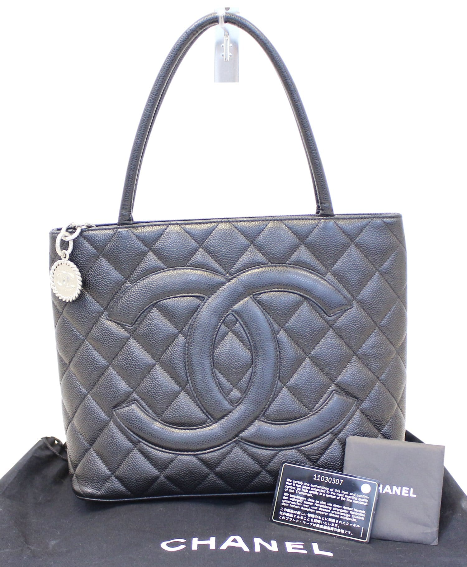 a36c168c58e4 CHANEL Black Quilted Caviar Leather Medallion Tote Bag