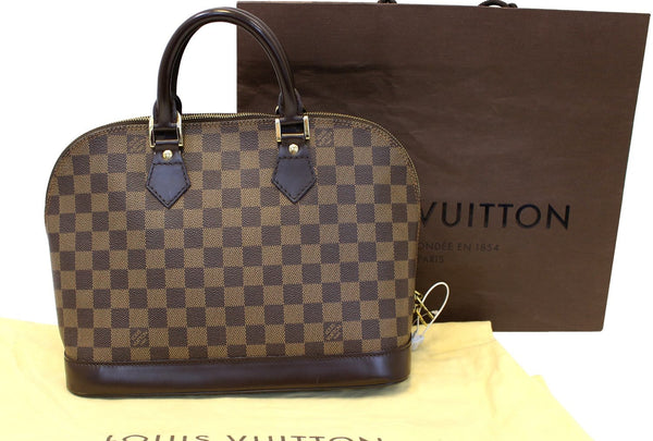 LOUIS VUITTON Damier Ebene Alma Brown Handbag
