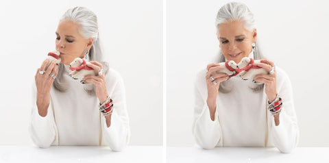 2 photos of Love Story actress Ali MacGraw with love bracelets holding 2 little toy puppies with pet collars
