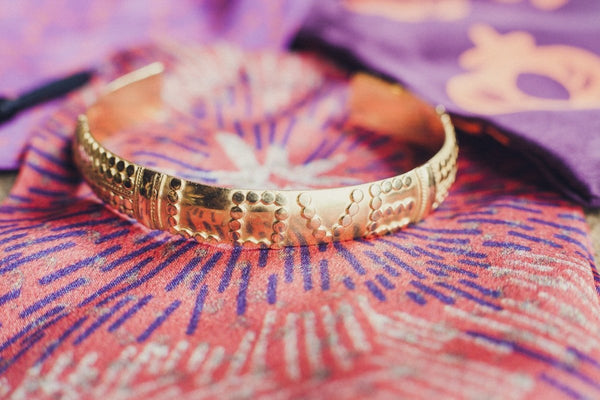 gold love bracelet handmade by artisans in bali for love is project with beautiful detail