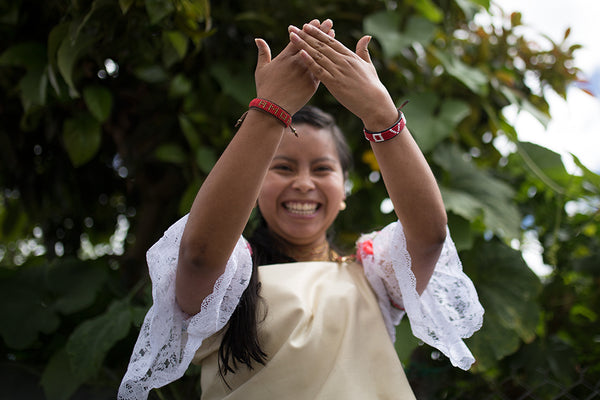 happy artisan in ecuador with love is project bracelet in nature
