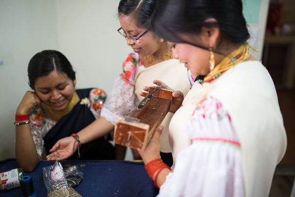 Artisans from Ecuador working with love is project
