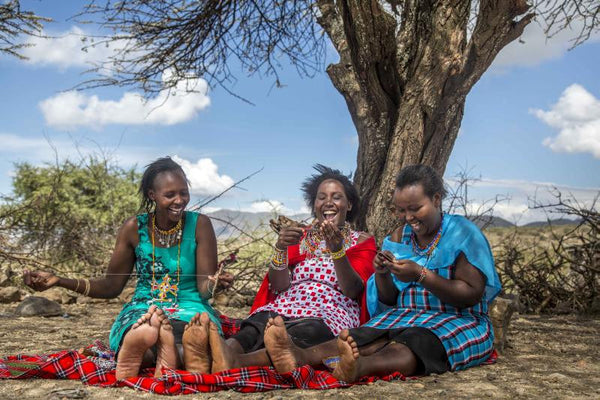 maasai women in kenya making love is project bracelets sharing laughter and love