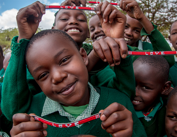 Maasai children with the Love Is Project red love bracelets Kenya
