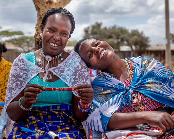 Maasai women beading Love is project bracelets