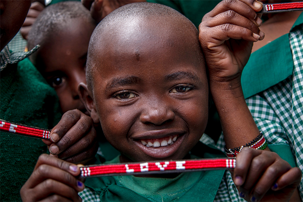 Maasai children with Love Is Project bracelets Kenya