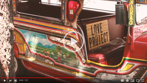Screenshot of a seat in a coach car with Love Is Project sign on it