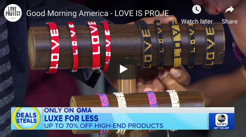 Screenshot from ABC's Good Morning America with love bracelets displayed on a brown pole