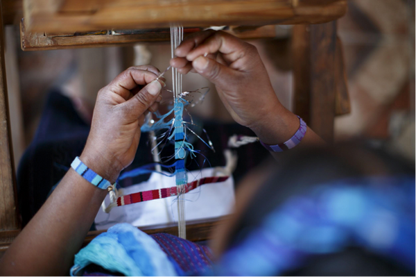 Guatemalan Artisans at work making Love Is Project bracelet