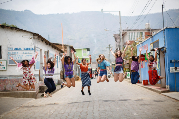 Happy women in the streets of Guatemala with Love Is Project bracelets