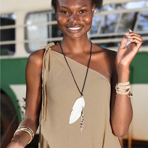 The White Feather Foundation collaborates with Love Is Project feather necklace Black and White