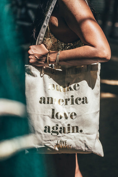 make america love again tote bag by Love Is Project gold and white