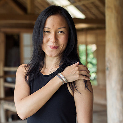 Lydia Lee Screw the Cubicle wearing Love Is Project silver love bracelets made in Bali