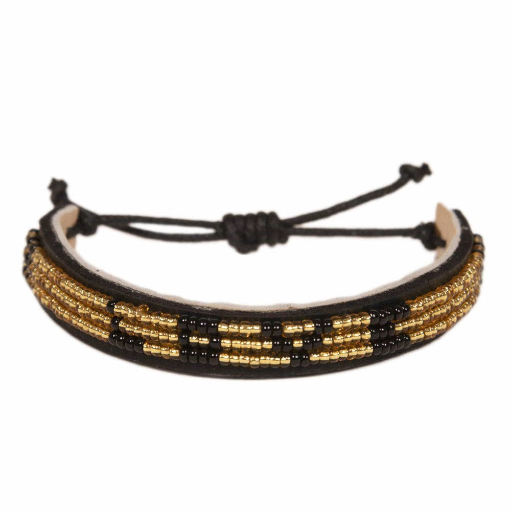 Skinny LOVE Bracelet - Gold/Black glass beaded leather bracelet creates jobs for women in Kenya. Love is Project