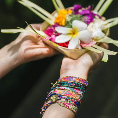 Bali Friendship Bracelets arm stack Love Is Project woven bracelets by artisans in Indonesia. Glass Beaded bracelets creates jobs.