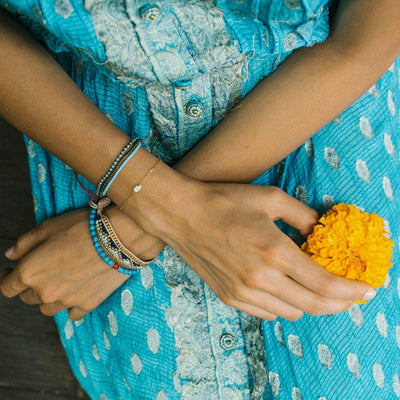 Taj Beaded Bracelet - Jodphur Blue hand made beaded bracelet by artisans in India. Love Is Project Charity bracelet creates jobs for women worldwide.