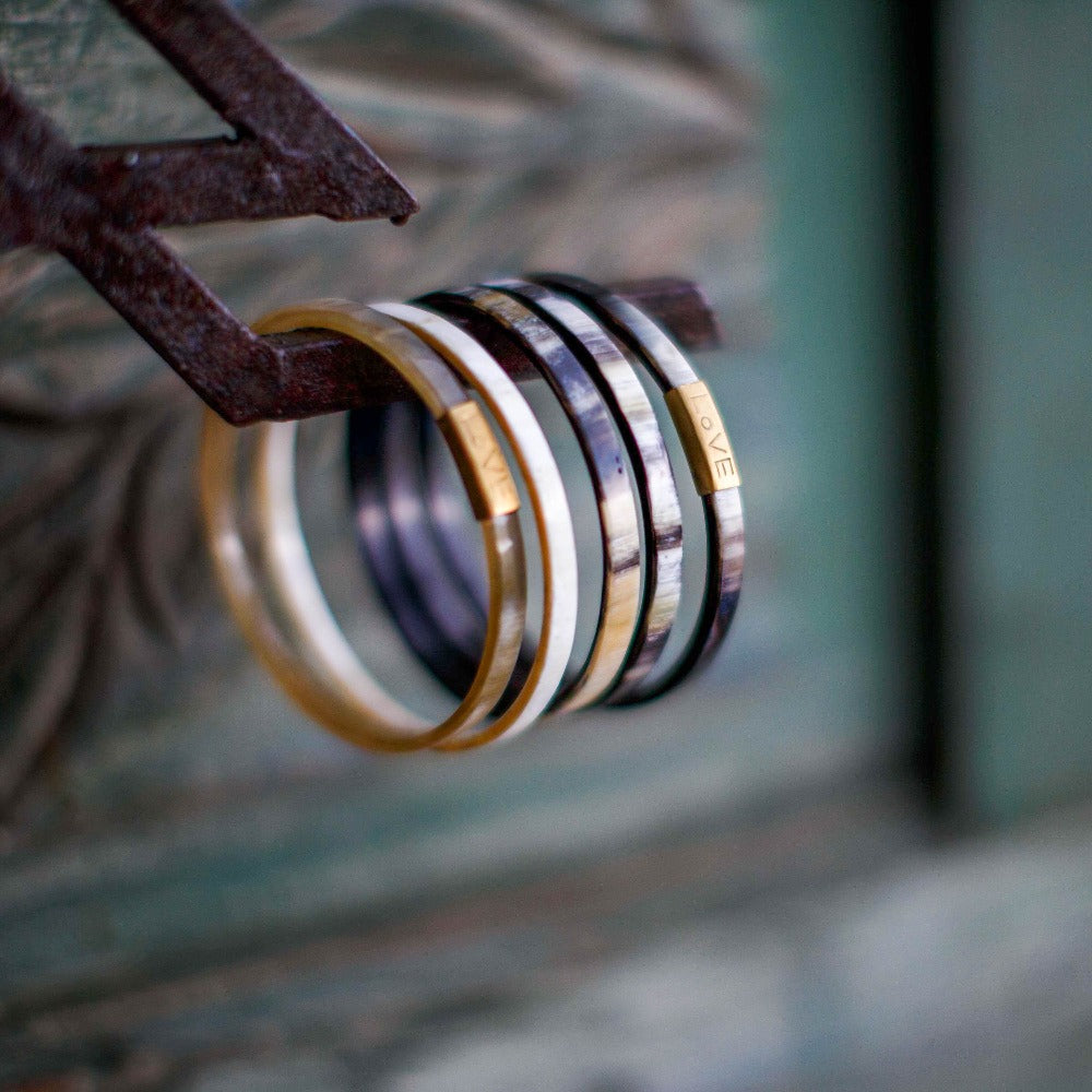 Trinity Horn Bangle - Tortoise bangle bracelets hand made by artisans. Love Is Project creates jobs for women worldwide.