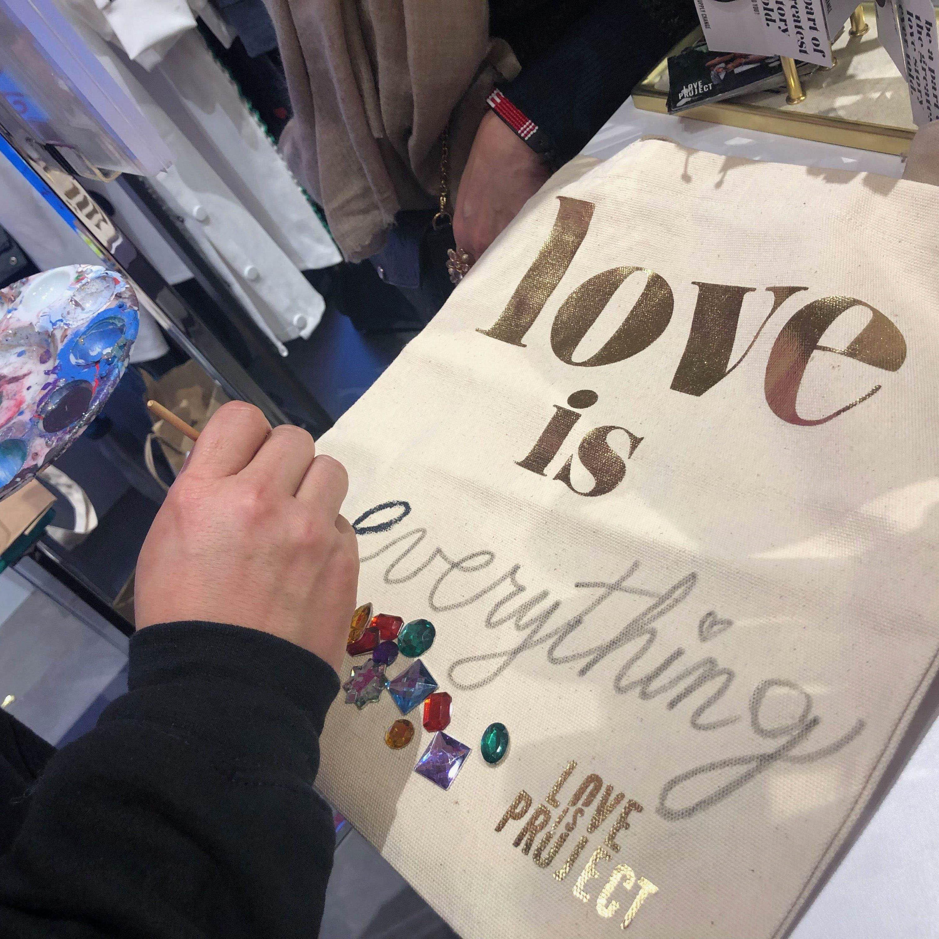 Love Is Tote - Canvas gold foil Love Is Project customizable tote made in Indonesia. Creates Job.