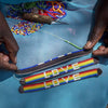 LOVE Bracelet - Rainbow Love Is Project glass beaded leather bracelet made in Kenya. Creates Jobs for Maasai women. Charity bracelet