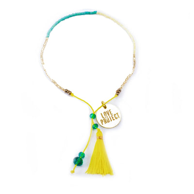 Bali Unity beaded Bracelet - yellow glass beaded bracelet creates jobs for artisans in Indonesia.