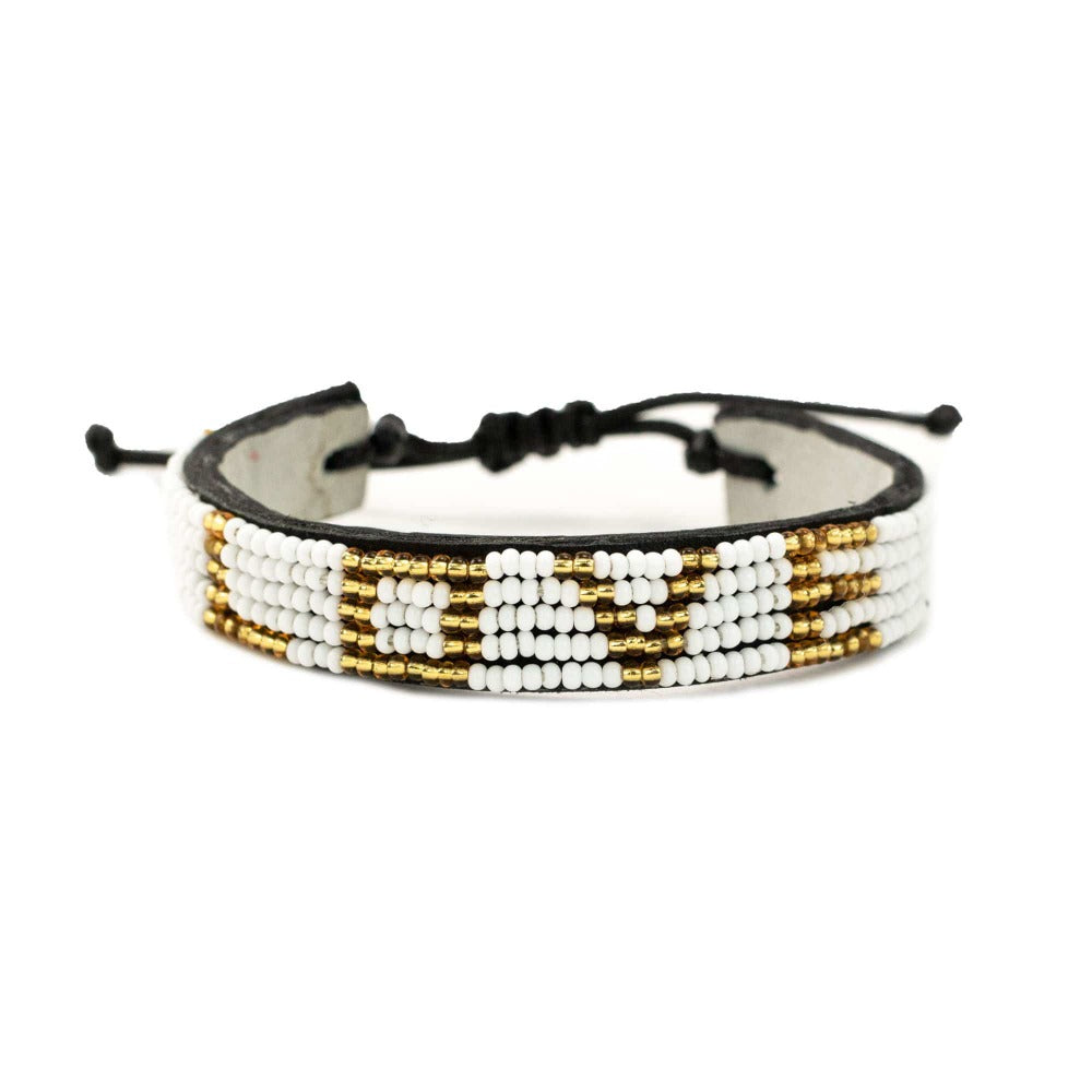 LOVE Bracelet - White/Gold hand beaded leather bracelet. Love Is Project creates jobs worldwide for artisans.