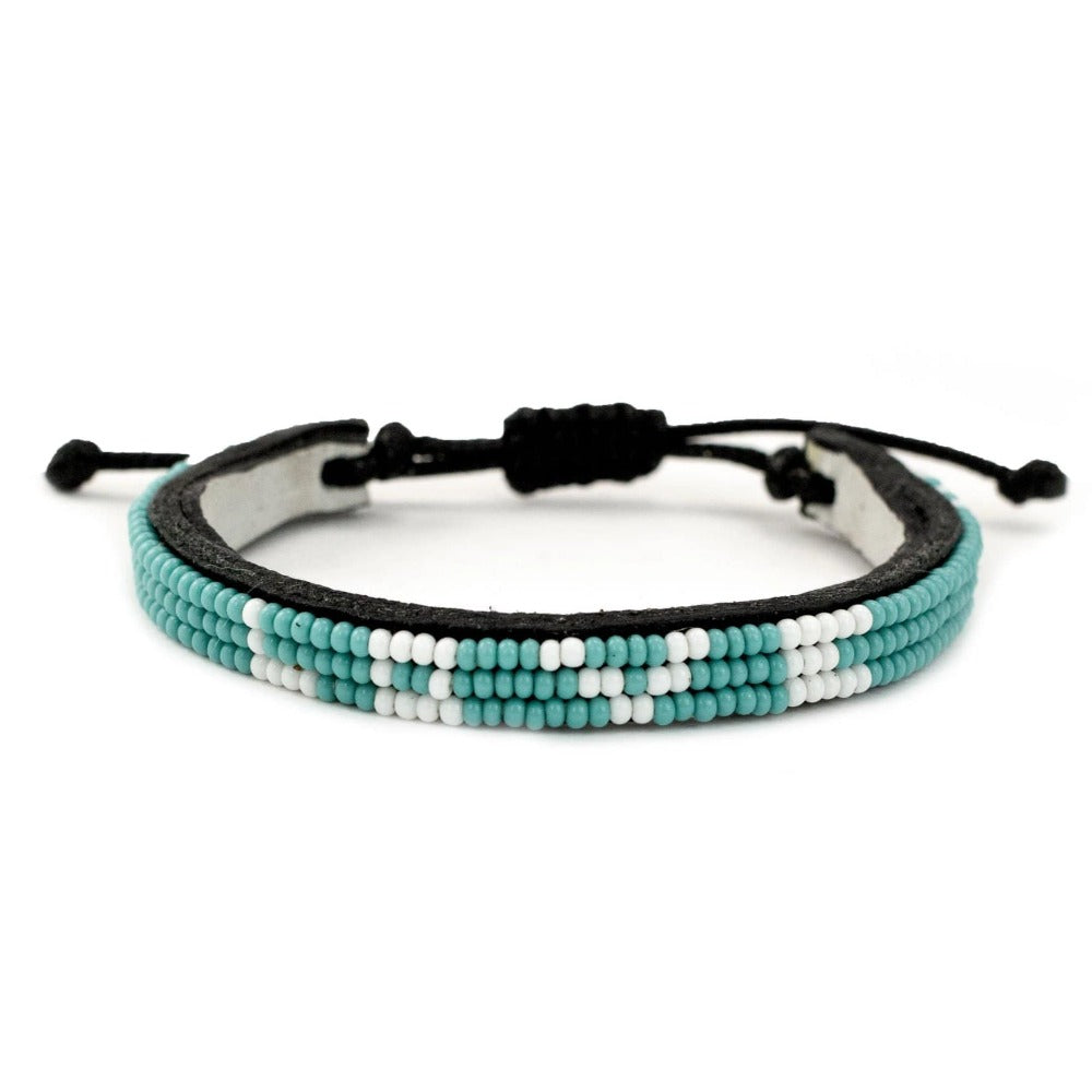 Skinny LOVE Bracelet - Turquoise glass beaded leather bracelet creates jobs for women in Kenya. Love is Project