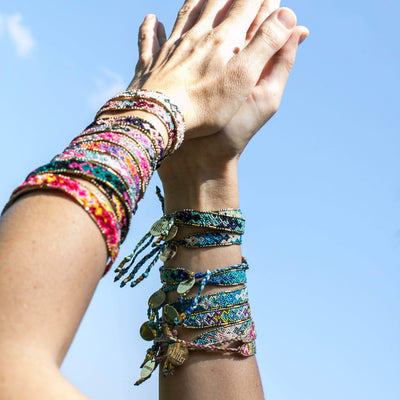 Bali Friendship Bracelet arm stack Love Is Project woven bracelets by artisans in Indonesia. Beaded bracelets creates jobs.