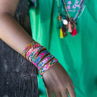 Bali Friendship Bracelets - Love Is Project woven bracelets by artisans in Indonesia. Beaded bracelets creates jobs. Worn on child