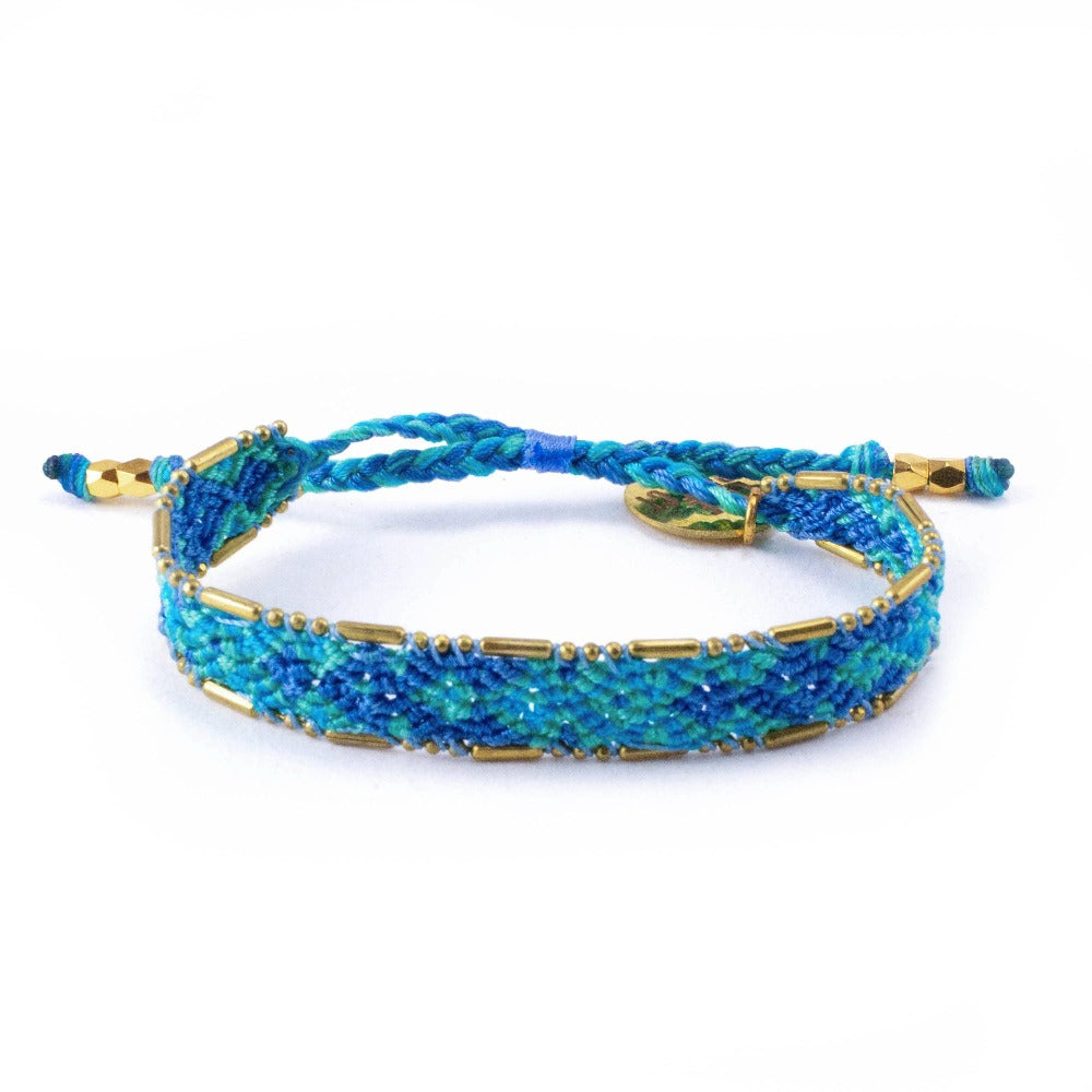 Bali Friendship Bracelet - Lagoon Blue Love Is Project woven bracelets by artisans in Indonesia. Beaded bracelets creates jobs.