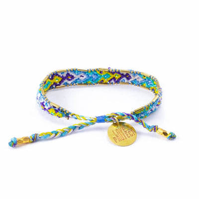 Bali Friendship Bracelet - Lagoon Ice back view Love Is Project woven bracelets by artisans in Indonesia. Beaded bracelets creates jobs.