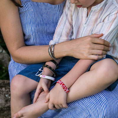 Kids' Seed Bead LOVE Bracelet - Red made by artisans in Bali, Indonesia. Glass beaded bracelet Love is Project creates jobs for women.
