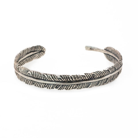 The White Feather Foundation x Love Is Project offering Balinese artisan made unisex silver feather cuff