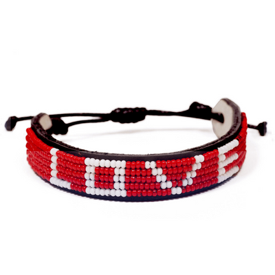 LOVE (Original) Bracelet - Red made by Maasai artisans in Kenya. Love Is Project creates jobs for women worldwide with our glass beaded leather bracelets