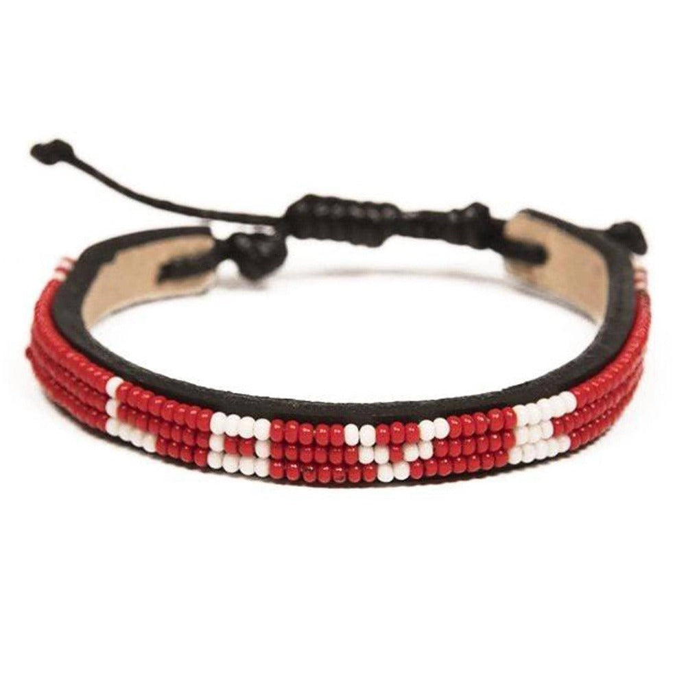 Love is project SKINNY love bracelet red handmade in Kenya. Love Is Project creates jobs for women worldwide with our glass beaded leather bracelets. Seen on Good Morning America and CNN.