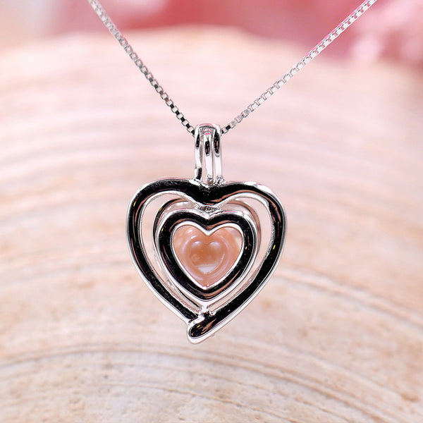 Beating Heart Sterling Silver Cage Pendant