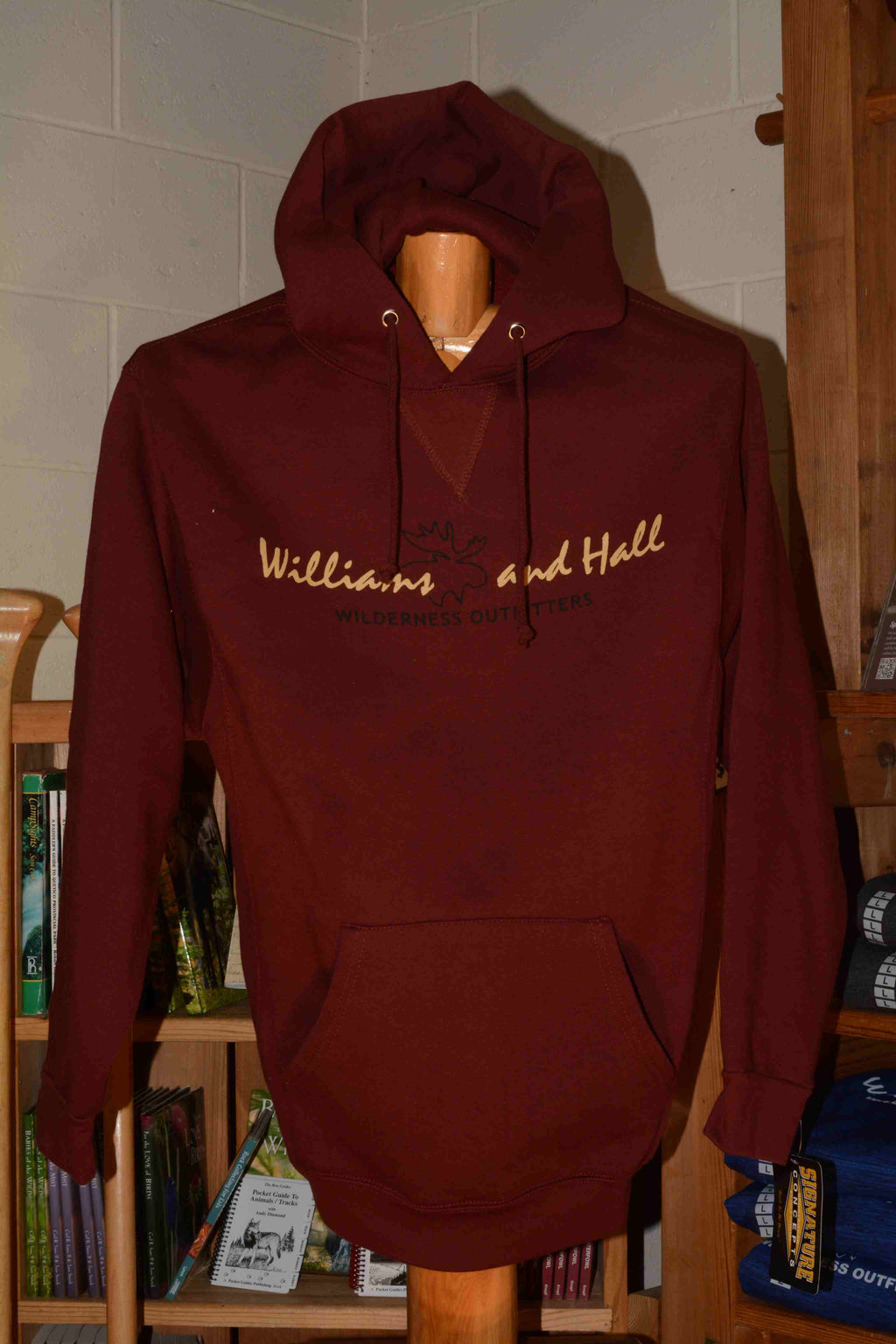 Sweatshirt featuring Williams and Hall Outfitters logo