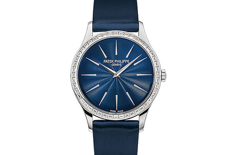 Patek Philippe Calatrava Ladies 4897/300G-001 - White Gold on Blue Satin - Blue Dial w/ Diamond Baguette Bezel