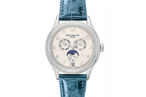 Patek Philippe Complications Annual Calendar Ladies 4947G-001 - White Gold on Blue Leather - Silver Dial w/ Diamond Bezel