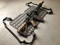 Rifle mounted to molle panel as gun holder