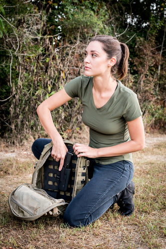 women with backpack and pulling pistol for molle panel insert