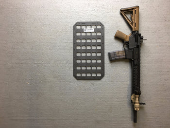 Rifle next to backpack insert to show size