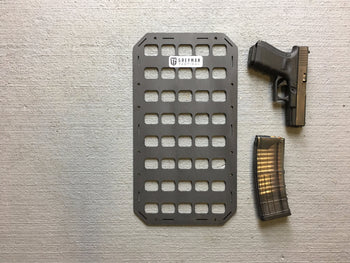 molle panel with pistol to show size