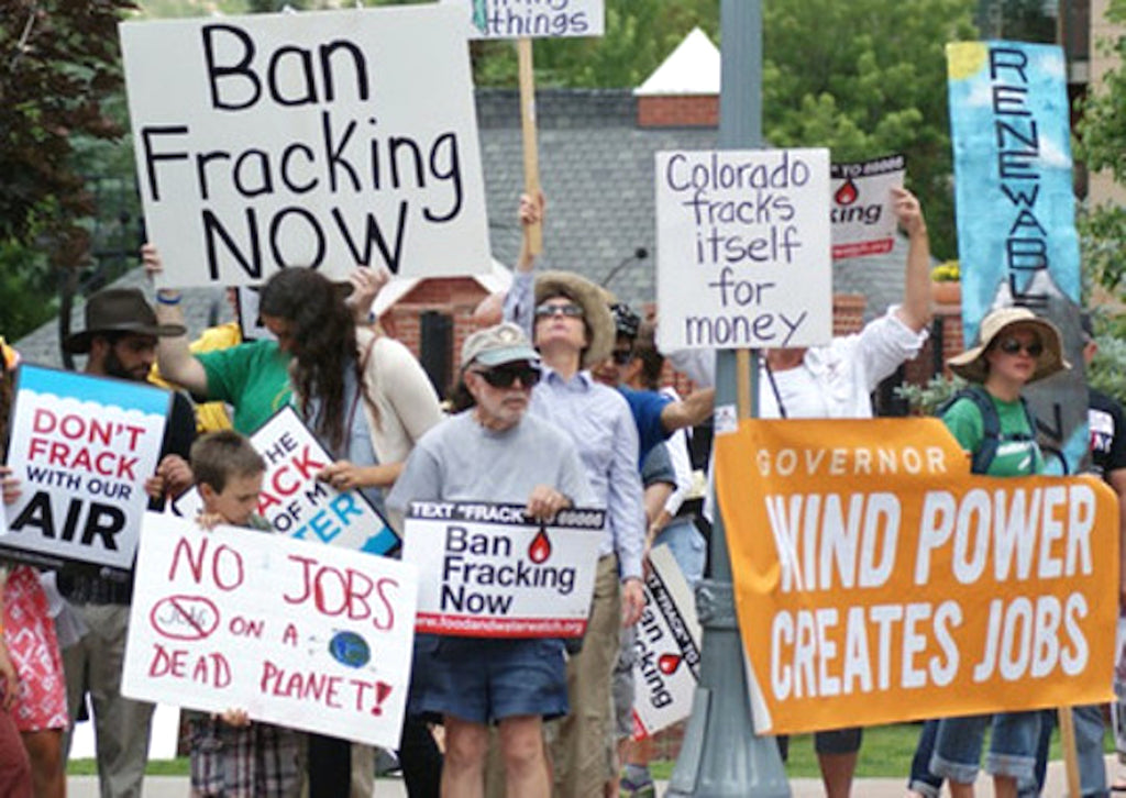 protestors-ban-fracking-signs-climate-change