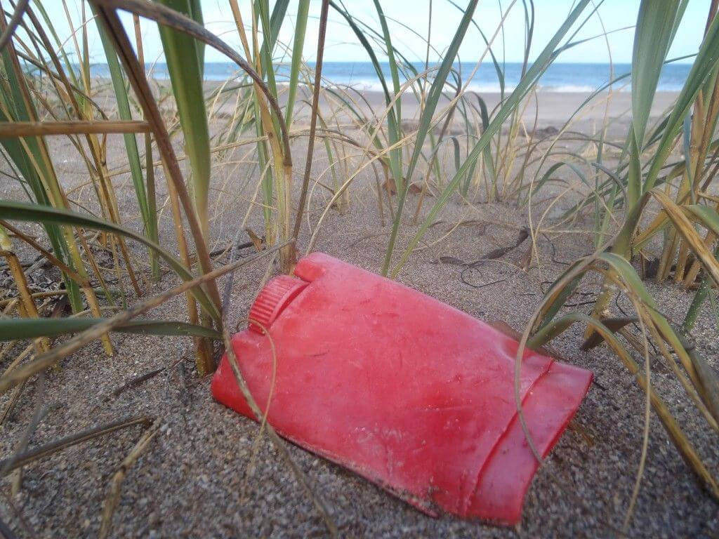 plastic-deodorant-tube-left-on-beach