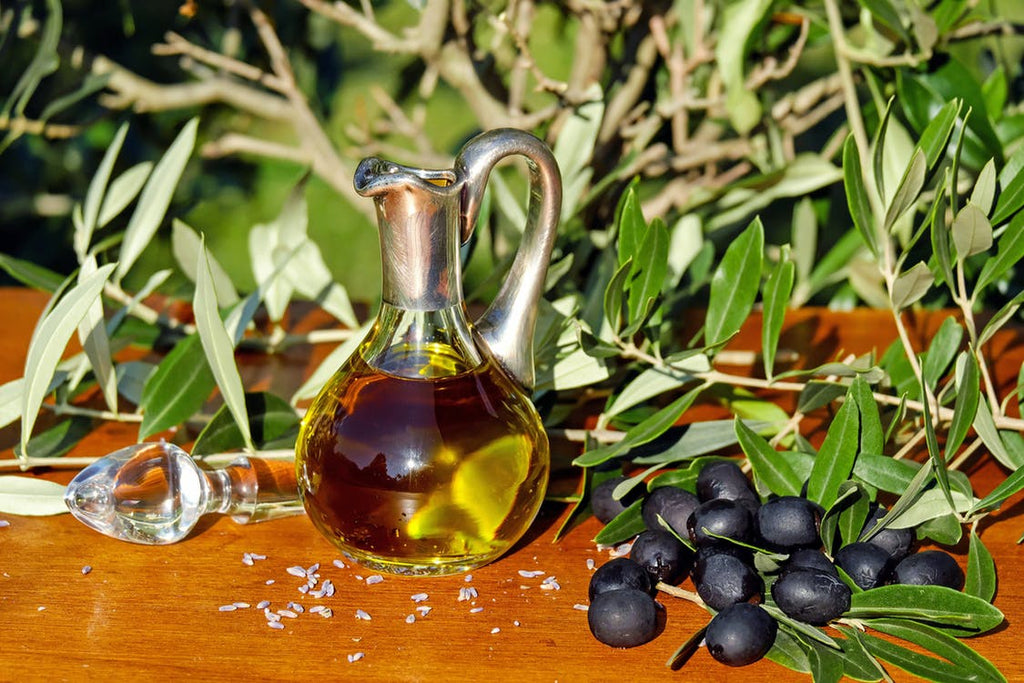 olive-oil-ingredients-olives-leaves-organic