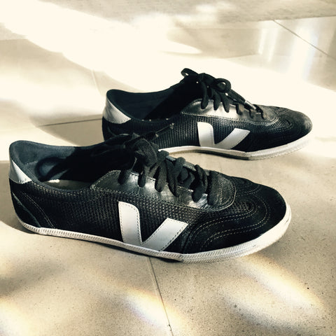 black-and-gray-veja-shoes-in-sunlight