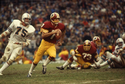 Theismann eludes the rush