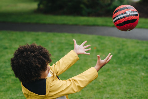 Kid playing with ball