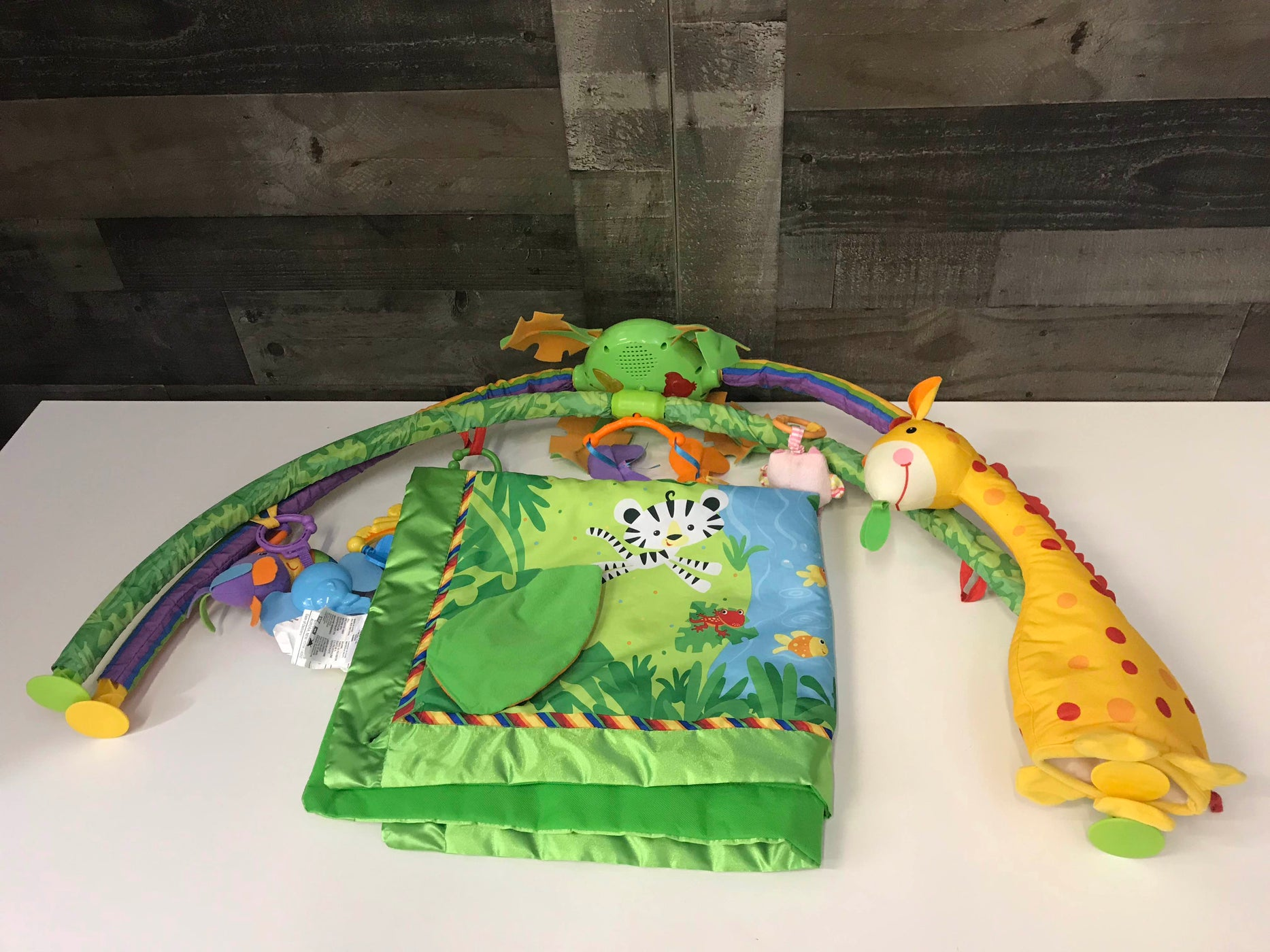 used Fisher Price Rainforest Melodies and Lights Deluxe Gym
