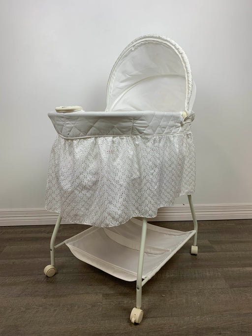 used Delta Children Deluxe Gliding Bassinet